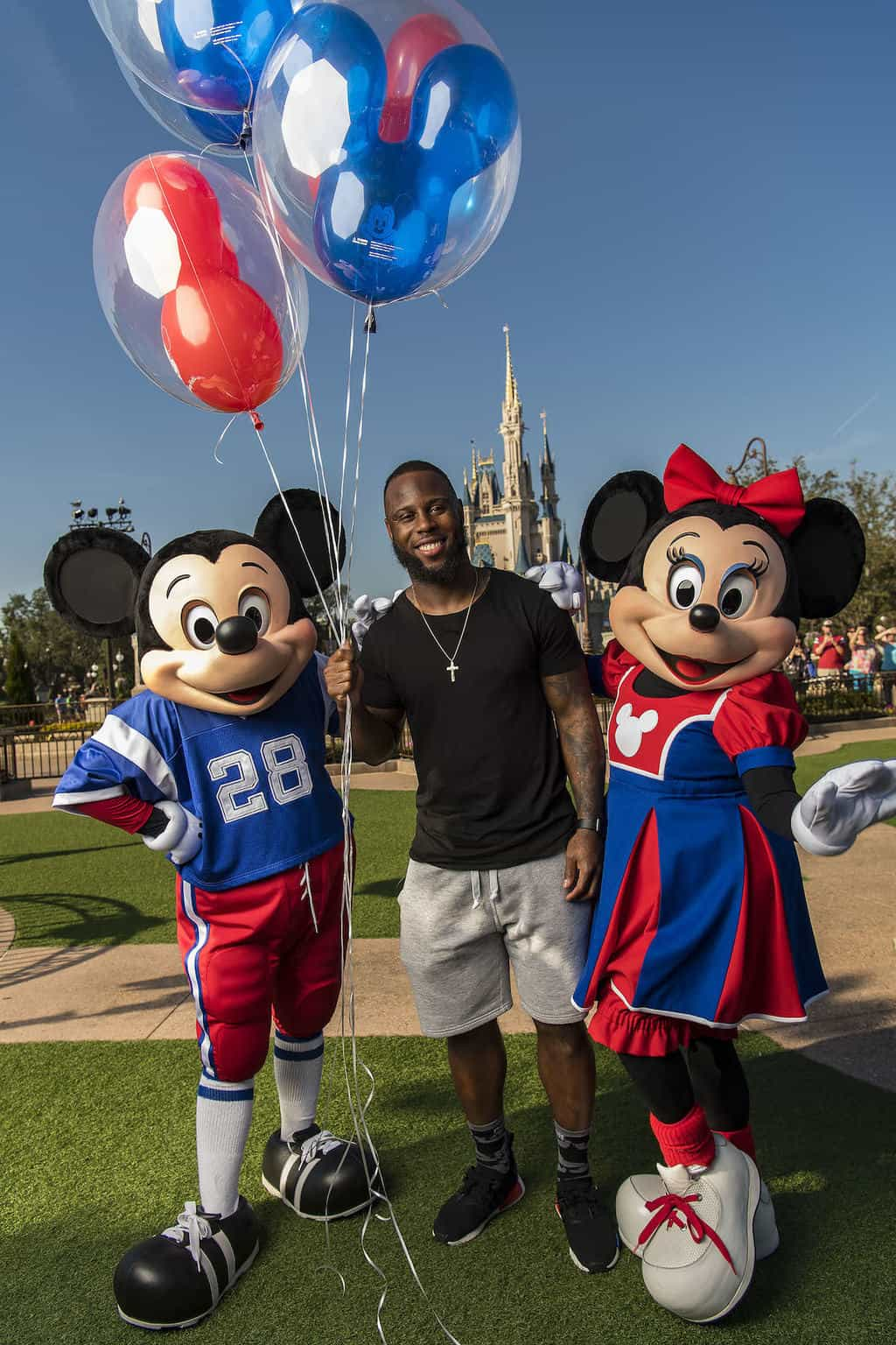 NFL Super Bowl star running back James White joins Mickey Mouse and Minnie Mouse after starring in a milestone Disney moment Monday, Feb. 6, 2017 (Matt Stroshane, photographer)